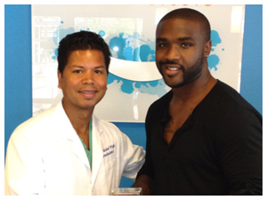 Dr. Wright with Derrick Williams